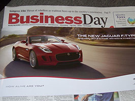 Jaguar-Newspaper-wraps-SLOW-Lounges